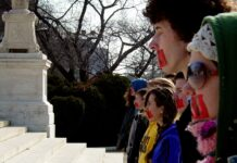 A pro-life group is symbolically gagged during a vigil in front of the Supreme Court in Washington DC. Photo by Ben Schumin on February 1, 2006.